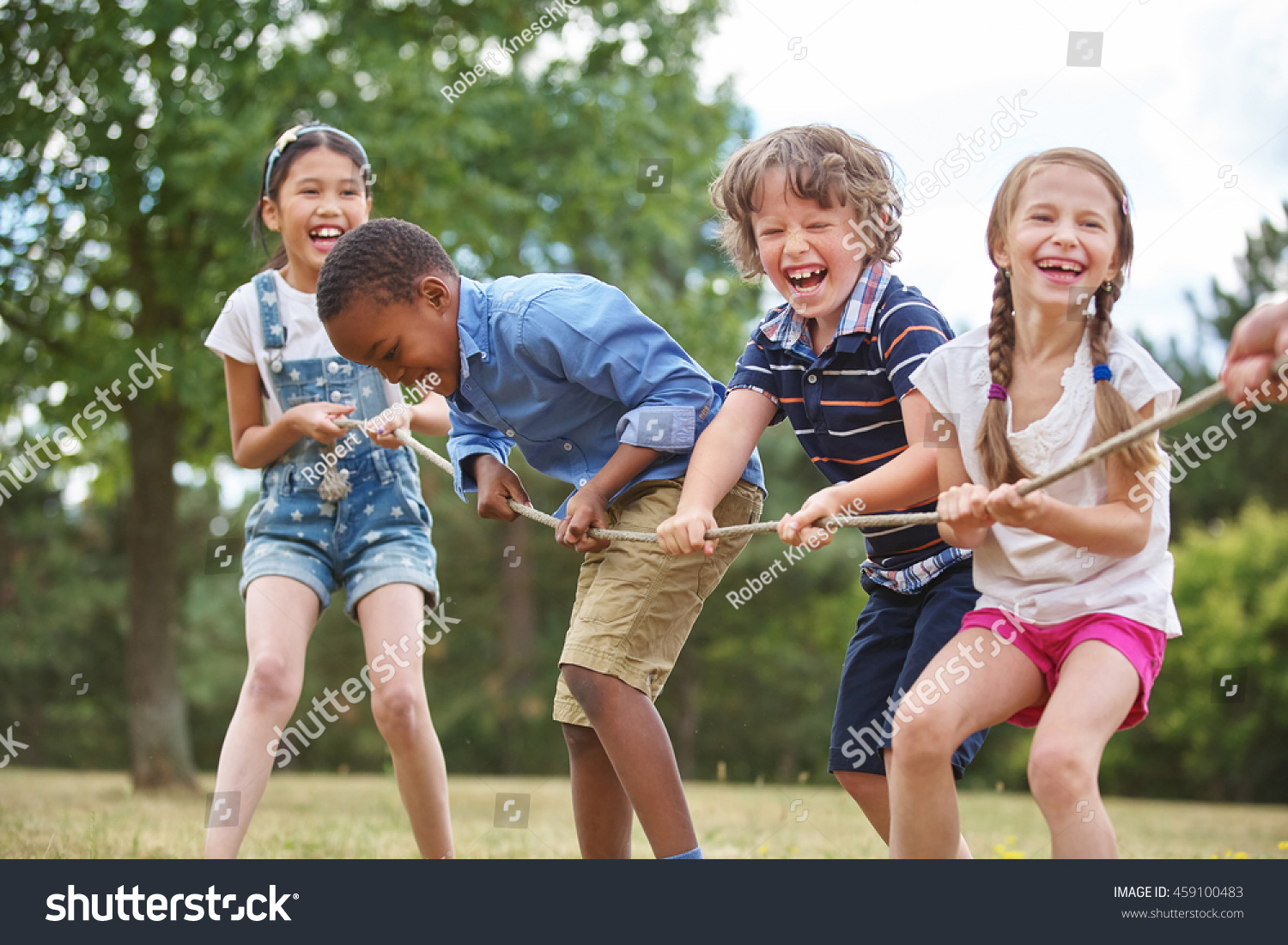 stock-photo-children-playing-tug-of-war-at-the-park-459100483